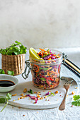 Crunchy salad with shredded cabbage, spring onion, carrots, coriander, quinoa with paenut and lime soy dressing