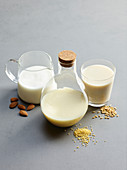 Three types of vegetable milk: almond milk, quinoa milk and cereal milk