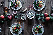 Quinoa salad with tomatoes on an autumnally decorated table