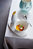 Cream of carrot soup and tartare with steamed onions and sesame seeds