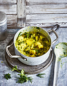 Potato and cauliflower stew with coconut milk and dill