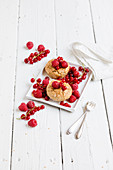 Almond cakes with red berries