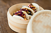 Traditional Asian sandwich steamed bun with meat and vegetables