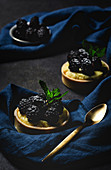 Homemade small cake with blackberry and delicious cream of vanilla and mint