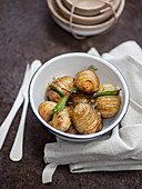 Hasselback potatoes with bay leaf and thyme