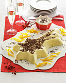 Upside down champagne-bavarian cream with grated chocolate and cream