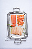 Smoked fish on a silver tray