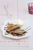Crêpes with chocolate cream and caramelised pears