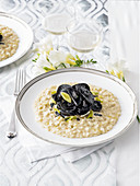 Leek and mushroom risotto with black seafood