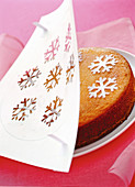 Vanilla cake decorated with snowflakes