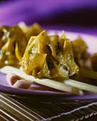 Asian pasta bag on chopsticks (close-up)