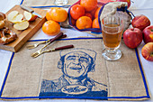 Decorative linen place mat with blue printed motif