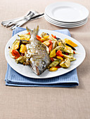 Striped seabream with Mediterranean vegetables and oregano