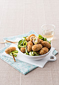 Meatballs with zucchini, tuna and sesame