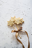 Star cookies on a stick, tied together with ribbon