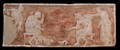 Painted bas relief of dog and cat fight.