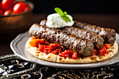Greek kebab with tomatoes and pita