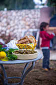 easter table with dolmas, easter eggs and freshly baked bread