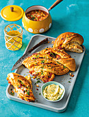 Knotted braai bread with sundried tomatoes and cheddar