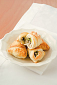 Puff pastry rolls with bacon and pistachio filling