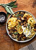 Tagliatelle with mushrooms, chickpeas, burrata and sage