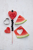 Fruit skewers of cut-out melon hearts
