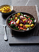 Beet salad with kale, almonds and pomegranate seeds