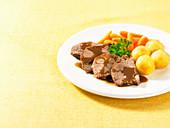 Sliced roast beef potatoes carrots yellow linen