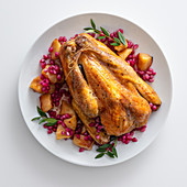 Guinea fowl with quinces, pomegranate seeds and myrtle