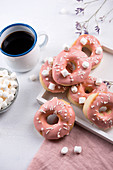 Vegan doughnuts with icing, sprinkles and marshmallows