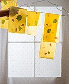Homemade lasagna sheets drying on hangers