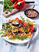 Salad with red lentils, zucchini, pepper, arugula, sunflowerseed