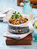 Vegetarian gratin with sausage, herbs, cheese