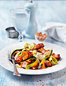 Zucchini and carrot zoodles with marinated tofu, peanuts and chiliflakes