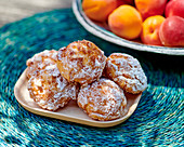 Profiteroles with apricots and icing sugar