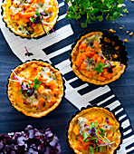 Mini pumpkin quiches with cress