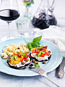 Stuffed Portobello mushrooms with peppers and capers served with gnocchi