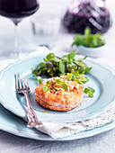 Spicy puff pastry topped with pine nuts, cheese and herbs