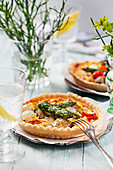 Mini vegetables tarts with asparagus, pepper and cheese