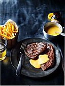 Steak with chips and sauce hollandaise