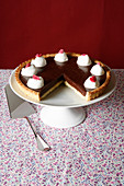 Chocolate tart with a dash of cream and sugared flowers