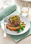 Tournedos with spicy gremolata on fried bread