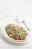 Spinach roulade with tomato sauce and basil
