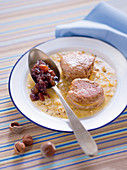 Pork medallions in cheese sauce with chopped hazelnuts and onion compote
