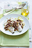 Steamed sea bream fillets with caper and olive pesto