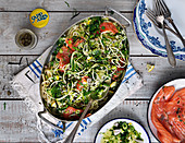 Pasta with salmon and zucchini, capers, lemon, herbs and leek