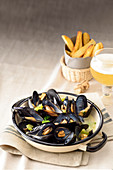 Mussels in beer brew with fries