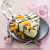 Pistachio ice cream heart with chocolate glaze and clementine fillets
