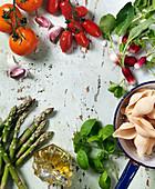 Tomatoes, radish, asparagus, pasta, basil, oliveoil, garlic