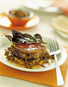Tournedos with lardo on lentils and vegetables